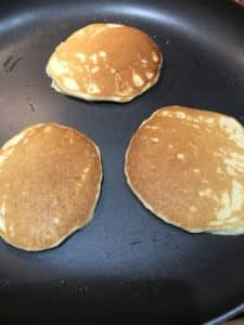 Pancakes cooking in pan.